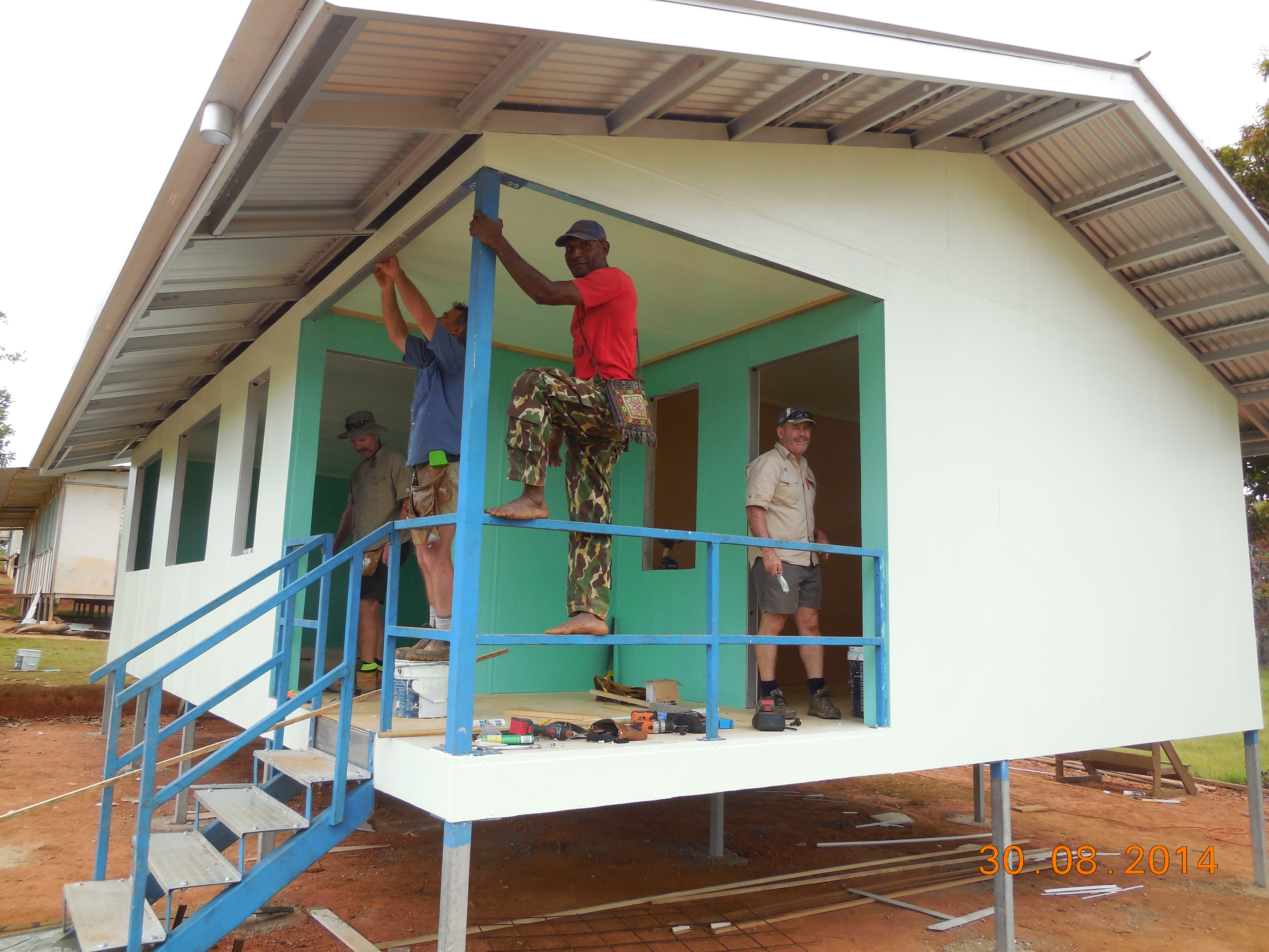 Abt staff volunteering to build classrooms in Papua New Guinea.
