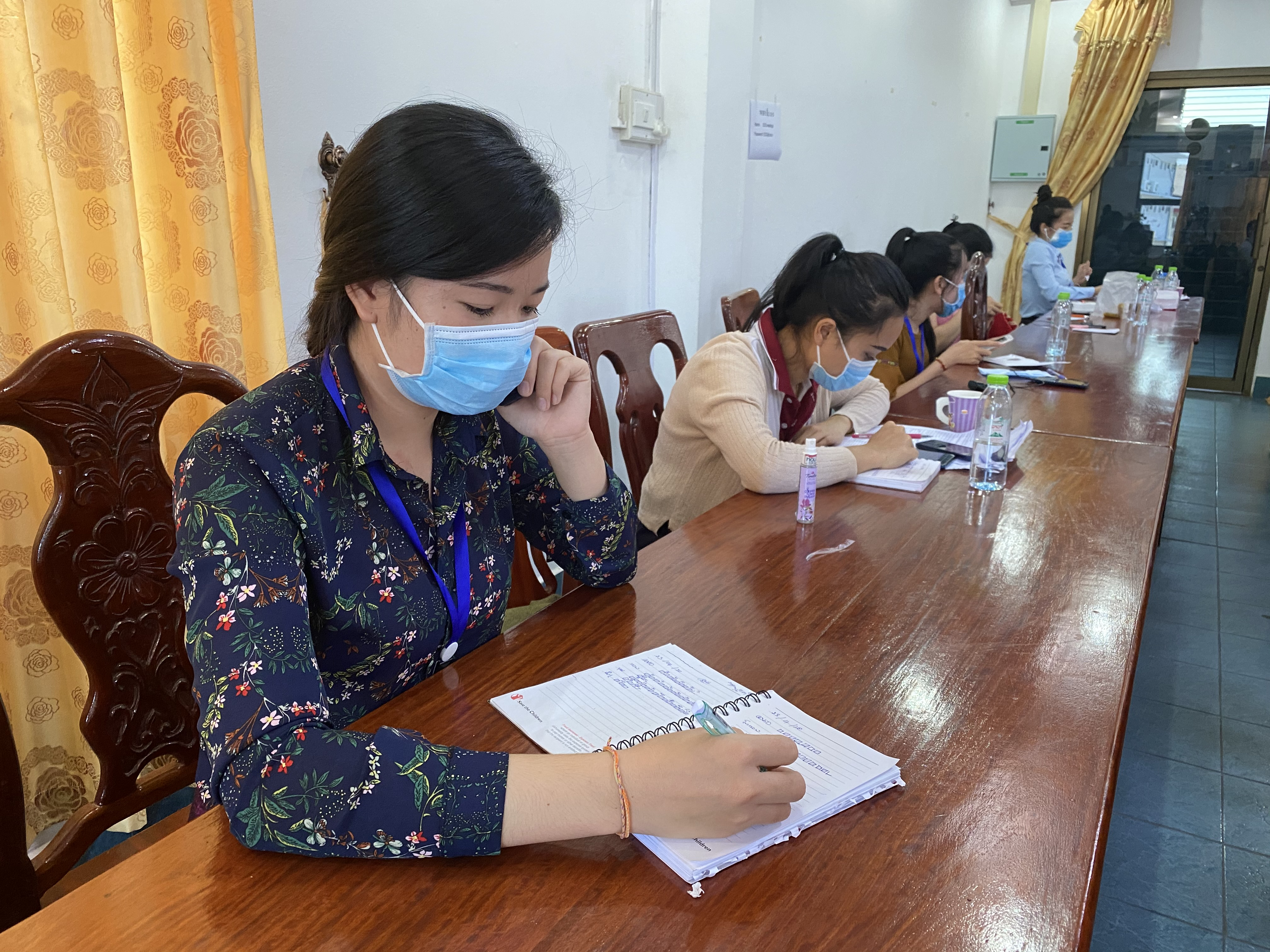 Answering the Call: Helping Field 5,000 COVID-19 Questions a Day in Laos