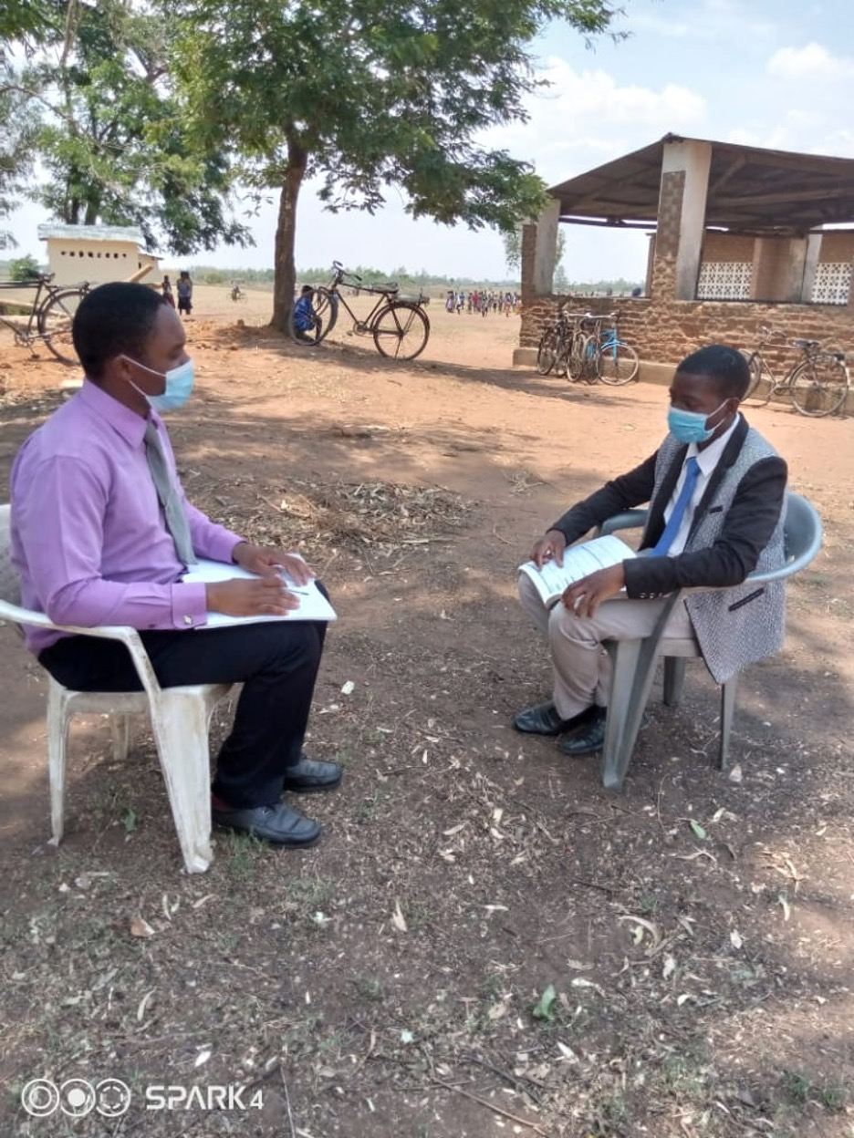 Micheal Mangalusa(Junior Section Head)  and Petro Kasawala(Std-3 teacher) engaged in coaching session at Nkondezi Primary School in Thuchila Education Zone Mulanje(Southern part of Malawi