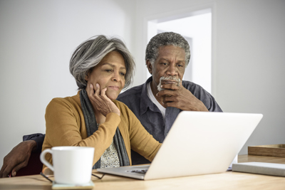 Older Couple reviewing laptop