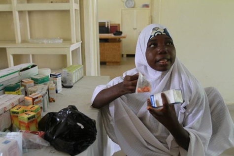 Adama Usman, 23, a farmer with four children, shows off the more affordable medicine she bought during a visit to the Hadejia General Hospital in Jigawa state, Nigeria