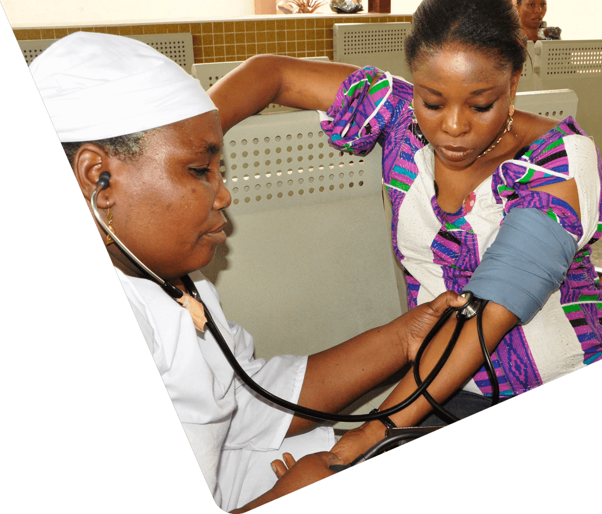 Doctor taking blood pressure with patient